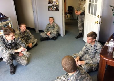 Cadets talking about the upcoming mission.